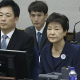 S. Korea's Ex-President Goes on Trial for Corruption