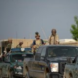 Afghan security personnel arrive at the site of the ongoing attack on the army compound in Dihdadi District of Balkh Province on April 21.