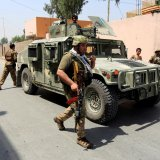 Afghan security forces arrive at the site of gunfire and attack in Jalalabad, Afghanistan, on July 11.