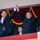 China's top legislator Li Zhanshu (L) and North Korean leader Kim Jong-un attend North Korea's 70th anniversary parade in Pyongyang, on Sept. 9.