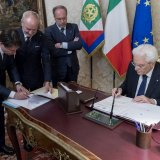 Italy's Prime Minister-designate Giuseppe Conte (L) and Italian President Sergio Mattarella sign documents at the Quirinal Palace in Rome on May 31.