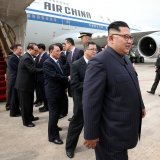 North Korean leader Kim Jong-un (R) arrives at the Changi International Airport in Singapore on June 10.