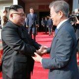 South Korean President Moon Jae-in (R) and North Korean leader Kim Jong-un at the truce village  of Panmunjom, South Korea, on April 27