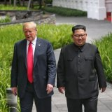 US President Donald Trump walks with North Korean leader Kim Jong-un  at the Capella Hotel on Sentosa island in Singapore on June 12.