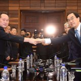 South Korean Unification Minister Cho Myoung-gyon (R) and Ri Son Gwon, chairman of the Committee for the Peaceful Reunification of the Country, meet at the truce village of Panmunjom inside the Demilitarized Zone, North Korea, on August 13.
