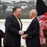 US Secretary of State Mike Pompeo (L) and Afghan President Ashraf Ghani shake hands after a press conference at the presidential palace in Kabul on July 9.