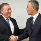 US Secretary of State Mike Pompeo (L) shakes hands with NATO Secretary General Jens Stoltenberg at NATO headquarters in Brussels on April 27.