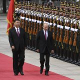 Russia's President Vladimir Putin (R) reviews a military honour guard with Chinese President Xi Jinping during a welcoming ceremony outside the Great Hall of the People in Beijing on June 8.