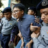 Detained Reuters journalist Wa Lone  is escorted by police after a court hearing in Yangon, Myanmar, on April 11.