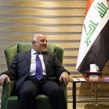 Iraqi Shia cleric Muqtada al-Sadr (R) speaks with Iraqi Prime Minister Haider al-Abadi in Baghdad, Iraq on May 19.