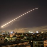 The Damascus sky lights up by missile fire, April 14. (Photo: Hassan Ammar, AP)