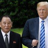 Donald Trump (R) and Kim Yong-chol