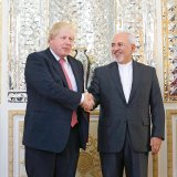 British Foreign Secretary Boris Johnson (L) meets Foreign Minister Mohammad Javad Zarif in Tehran on Dec. 9.