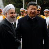 Iranian President Hassan Rouhani (L) shakes hands with Chinese President Xi Jinping during a welcoming ceremony on Jan. 23, 2016, in Tehran. (File Photo)