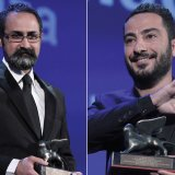 Vahid Jalilvand (L) and Navid Mohammadzadeh with their prizes (Photo: AFP)