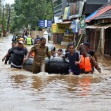 Rescuers evacuate people from a flooded area to a safer place in Aluva in the southern state of Kerala, India, on August 18.