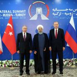 President Hassan Rouhani (C) stands next to Russian President Vladimir Putin (L) and Turkish President Recep Tayyip Erdogan ahead of a trilateral summit in Tehran on Friday.