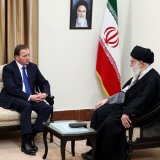 Ayatollah Seyyed Ali Khamenei receives Swedish Premier Stefan Lofven (C), as President Hassan Rouhani (L) looks on, in Tehran on Feb. 11.