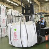 A worker loads bags of rice at a CP Intertrade Company warehouse in Thailand's Ayutthaya Province.