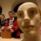 Blind people touch sculptures during a special exhibition for people with visual disabilities in Prague, Czech Republic.
