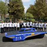 The student team poses with the Iranian Gazelle III at the College of Engineering of the University of Tehran.