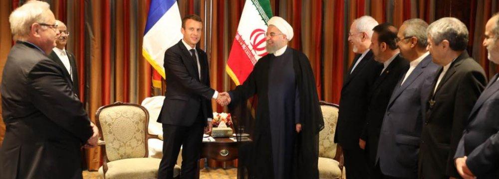 France Urged to Help Restrain Unilateralism