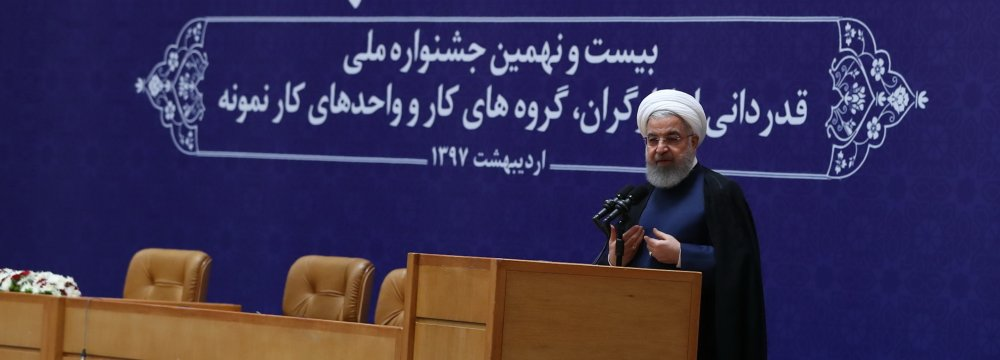 President Hassan Rouhani speaks at a ceremony in Tehran on April 29 to commemorate workers ahead of Labor Day.