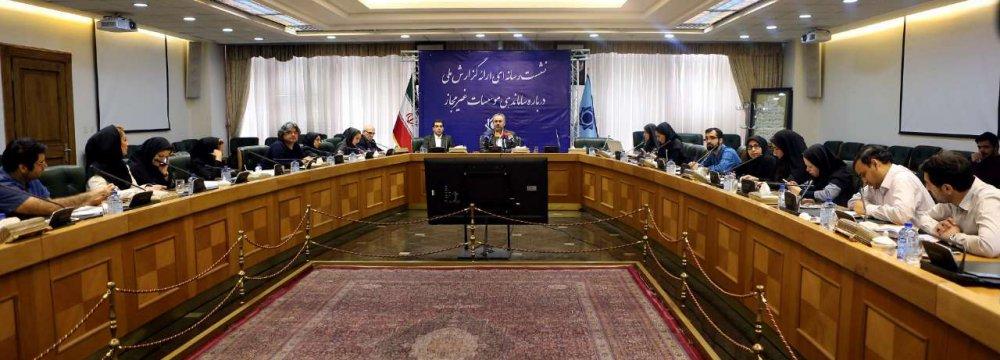 Farshad Heydari (C) addresses a press conference in Tehran.
