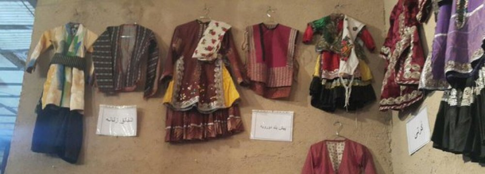 The local costumes of Abyaneh consist of long black trousers for men and a long floral dress for women.