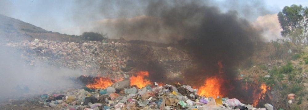 DOE Monitors Waste Burning
