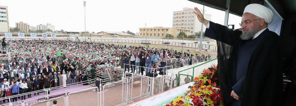 President Hassan Rouhani addresses a public gathering in Bandar Abbas, Hormozgan Province, on Feb 28.