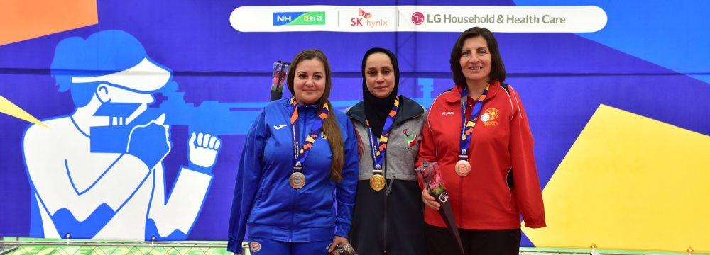 Sareh Javanmardi (C) won gold at the Cheongju 2018 World Shooting  Para Sport Championships.