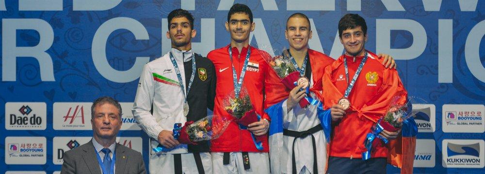 Ali Eshkevarian (left) took a silver medal in Tunisia.