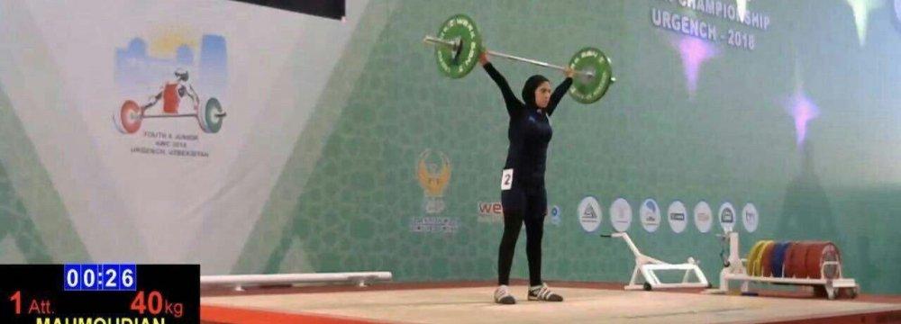 Parmida Mahmoudian lifts a weight at the Uzbekistan games.