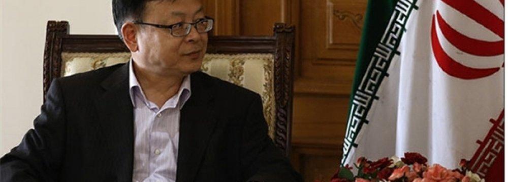 China Envoy Urges Enhanced Ties