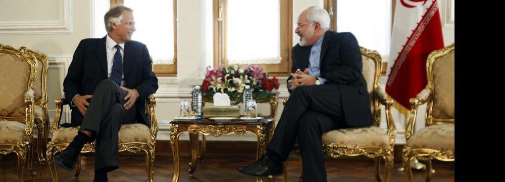Former French PM Calls on Zarif, Velayati