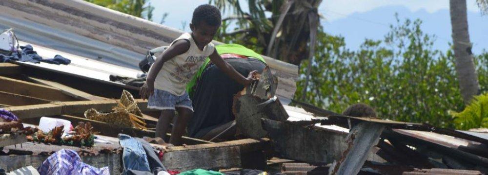 Fiji Cyclone Leaves Trail of Death, Destruction