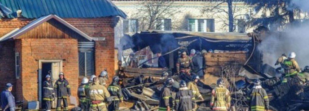 Fire Kills 21 at Russian Halfway House