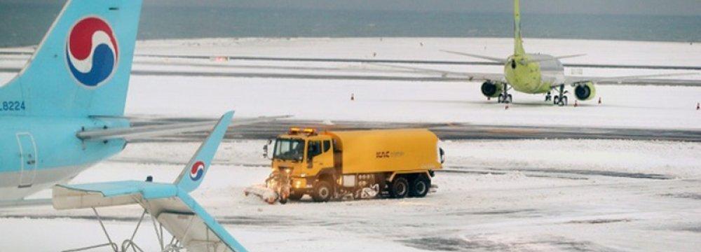 Dozens Dead in East Asia Cold