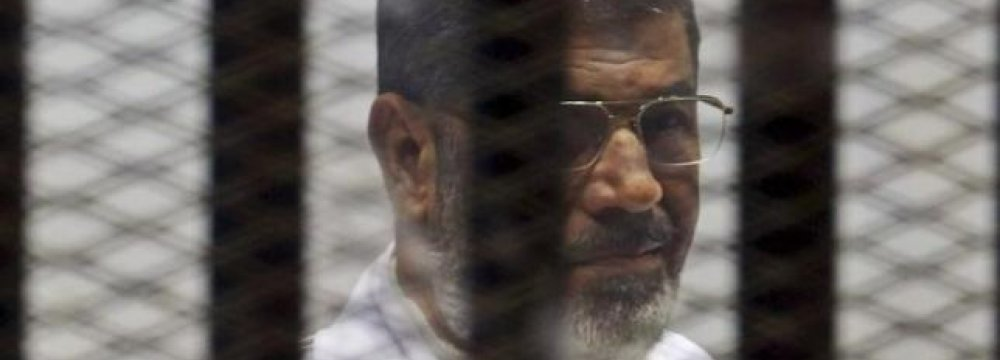 HRW Says Trial of Morsi 'Badly Flawed'