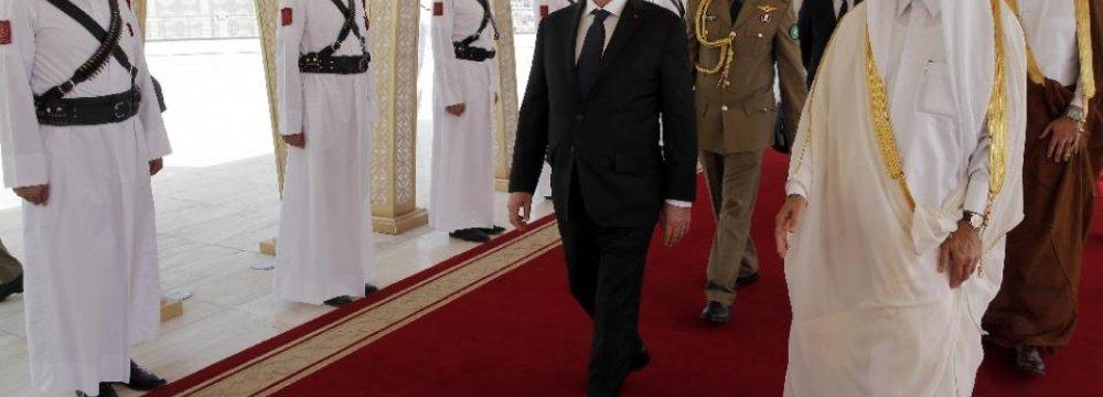 Hollande in Qatar for Warplane Deal