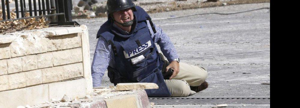 IFJ: 118 Journalists Killed in 2014