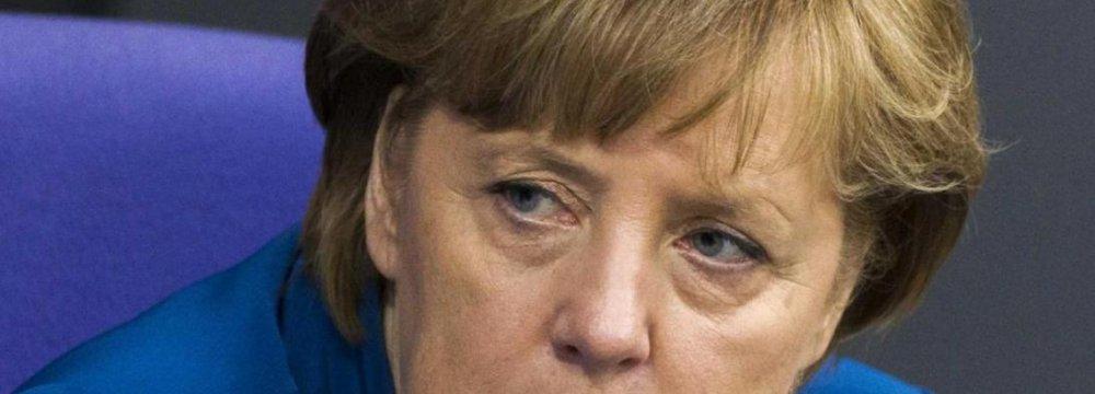 Merkel Hesitant To Ease Russia Sanctions
