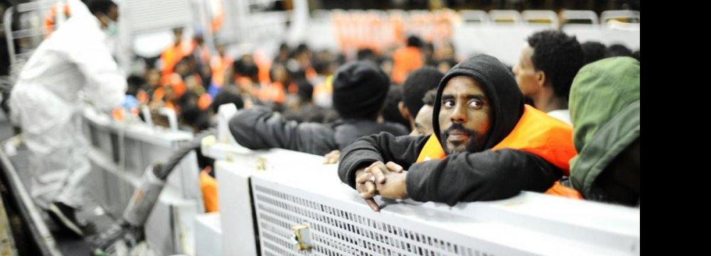 European Leaders Agree to Relocate 40,000 Migrants