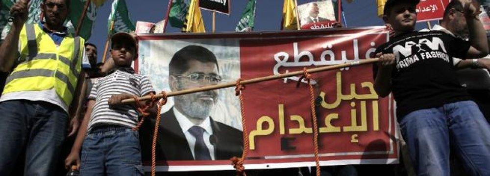Palestinians Protest Morsi Sentence