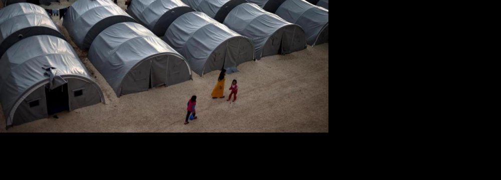 AI Censures Rich Nations'  Failure to Take Syria Refugees