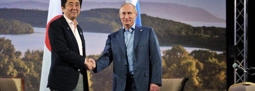 Japan, Russia Vow to Repair Ties
