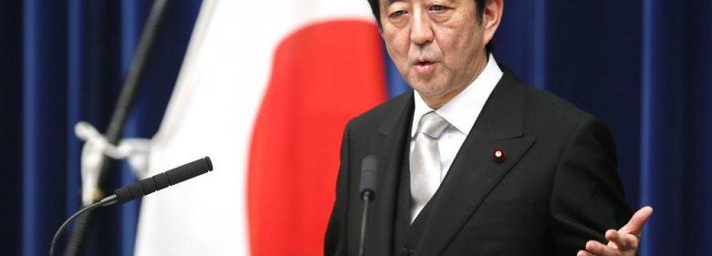 Japan Gov't Cuts Economic Assessment