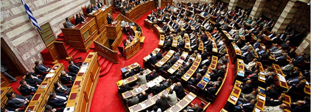 Greek Lawmakers Split Over Bailout