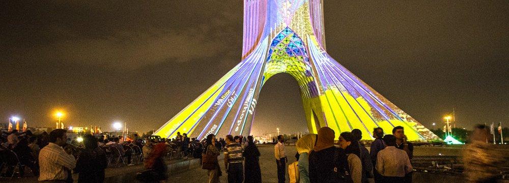 Tehran's Azadi Tower Lit With Poetic Words, Lights